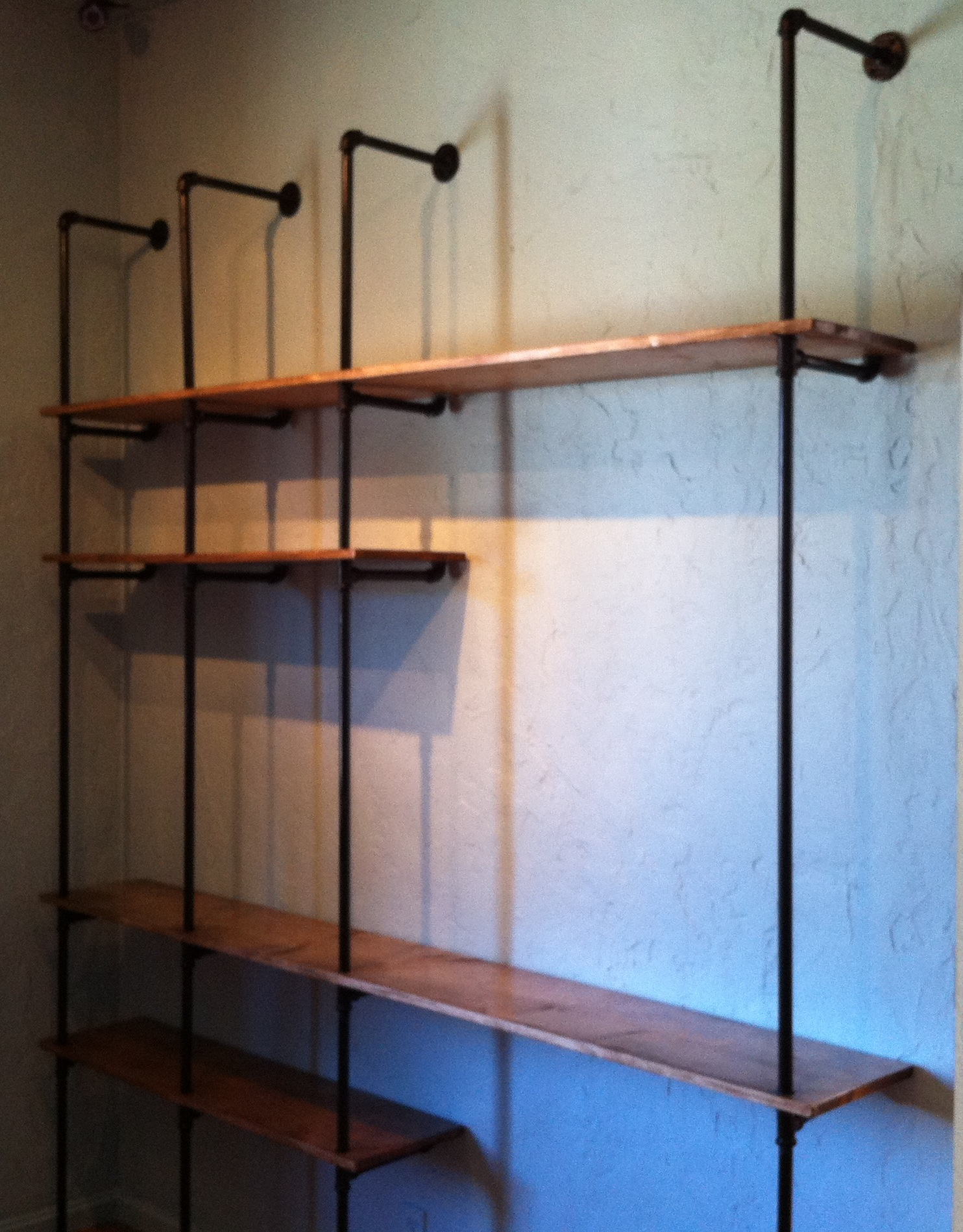 Pipe shelving unit at Oddyssea Half Moon Bay