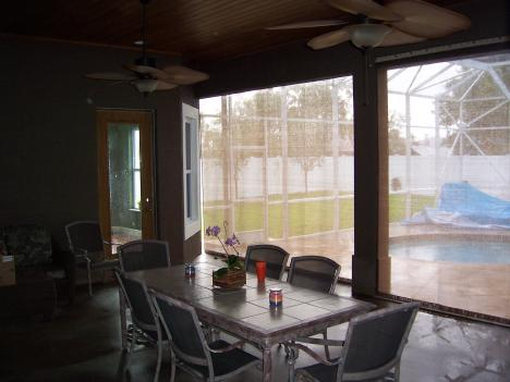 StormWatch Hurricane Shutters Installed over Patio Doors